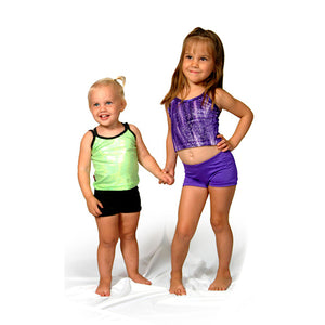 Two young kids wearing the basic bike shorts in black and purple
