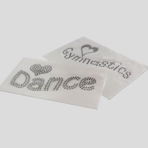 two diamante crystal iron on transfers with one saying dance and the other saying gymnastics