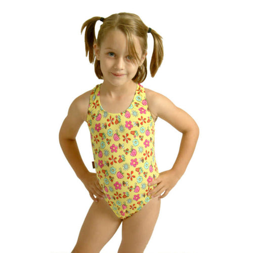 girl wearing our kids yellow garden print swimsuit