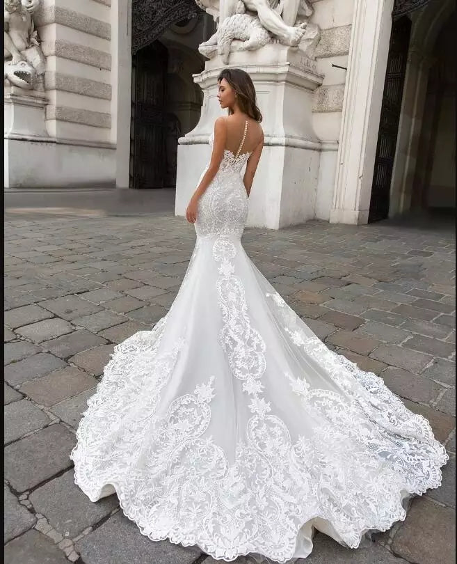 Elegant Lace Wedding Gown with Cape