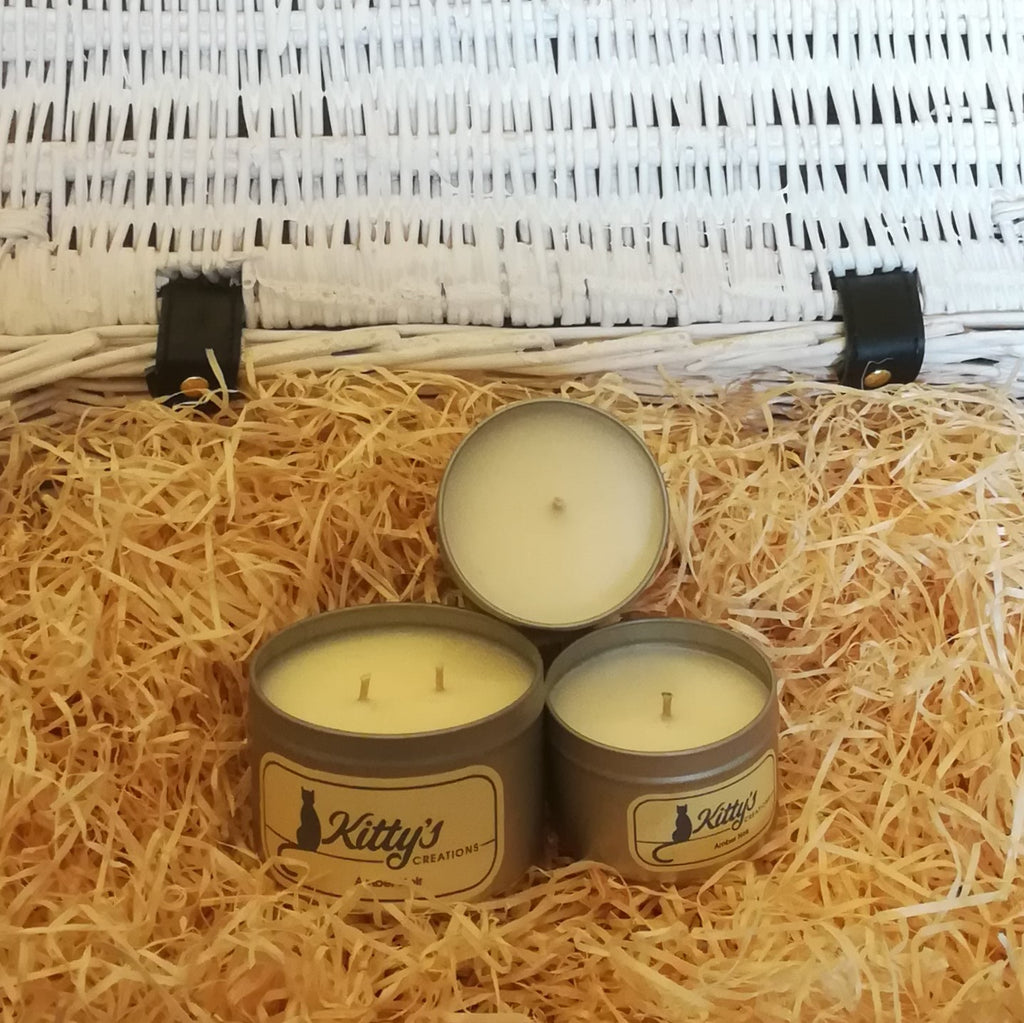 Three hand poured candles filled with amber noir scented soy wax, contained in travel tins with clear see through lids ready for you to take on your next adventure whether for work or pleasure.