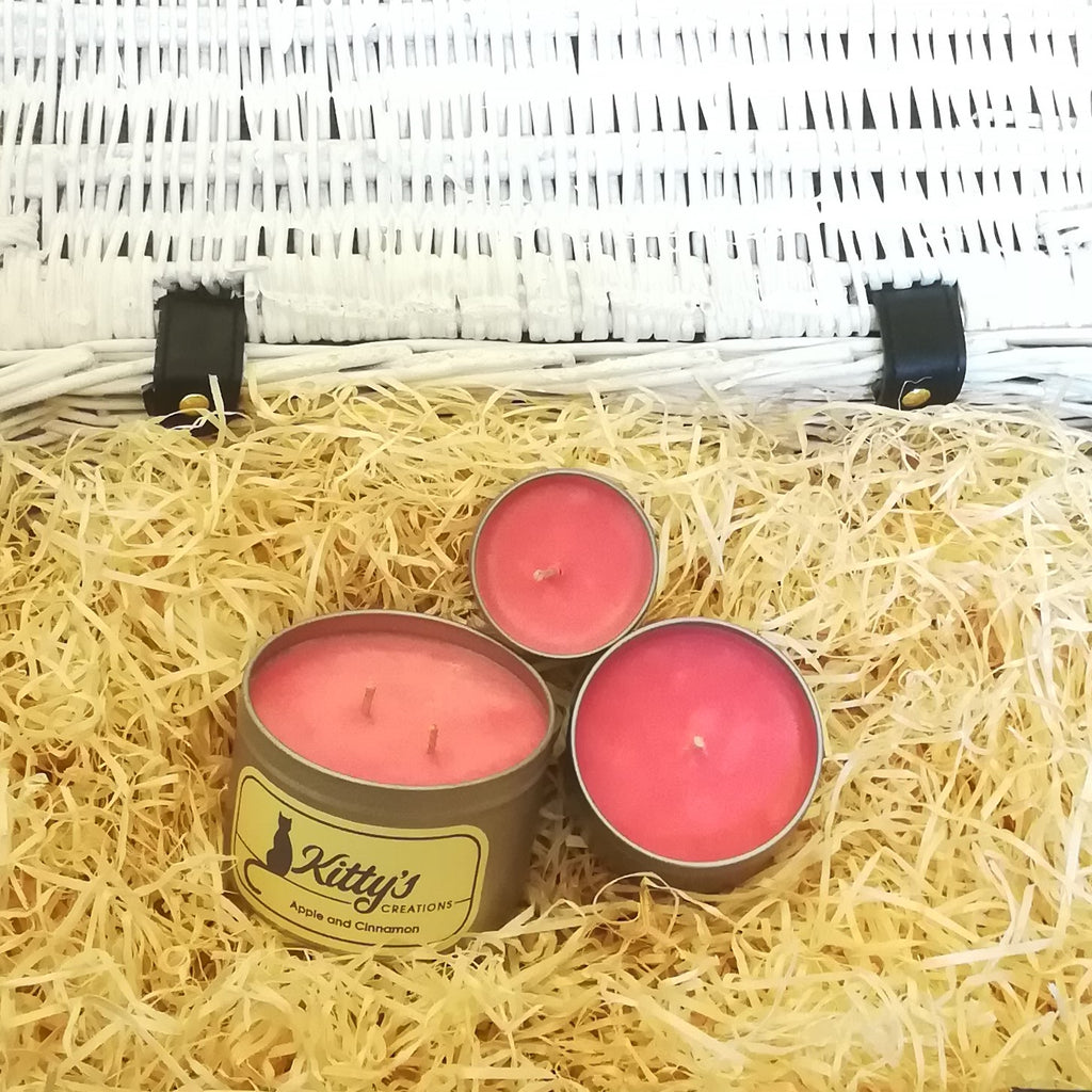 Three hand poured candles filled with apple and cinnamon fragranced soy wax, contained in travel tins with clear see through lids ready for you to take on your next adventure whether for work or pleasure.