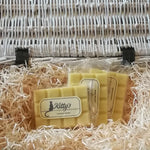 Three hand-made rectangular Wax Melts. Each is coloured a light refreshing yellow, are pictured resting in a basket of straw. A rich and creamy blend of Madagascan vanilla pods, nutmeg and crushed nuts, whipped to a delicious blend, better than any ice-cream you can imagine.