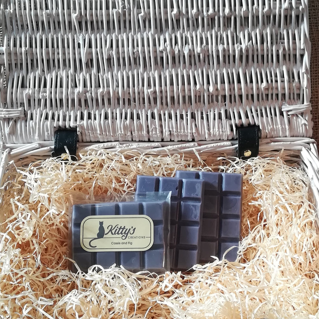 Three hand-made rectangular Wax Melts. Each is coloured a deep fig blue, the melts are resting in a basket of straw. Each melt is an enchanting mix of succulent plump figs, cherries and raspberries blended with cassis on a bed of creamy coconut that gives a luxurious warming Mediterranean feel that everyone will enjoy.