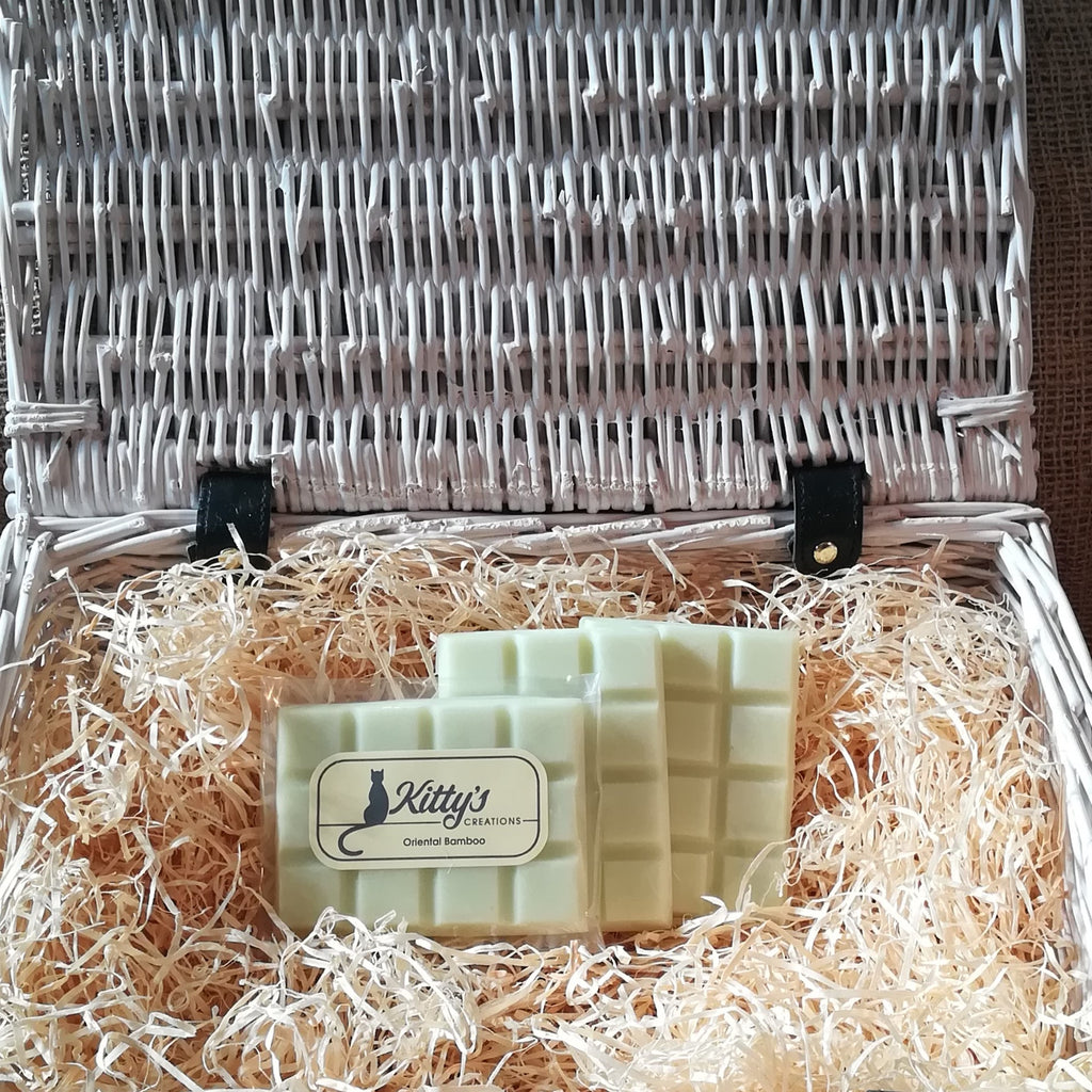Three hand-made rectangular Wax Melts. Each is coloured a jungle inspired pale green like the new growth shooting upwards, and resting in a basket of straw. This is a delicate fragrance that glides over a room to relax and calm as you are carried into the jungle.