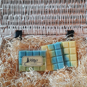 Three hand-made rectangular Wax Melts, each one coloured like a perfect tropical sea lapping over golden yellow sands, resting in a basket of straw. Each melt reveals a scent evoking the memory of warm sunshine caressing your skin as waves gently lap around your ankles.