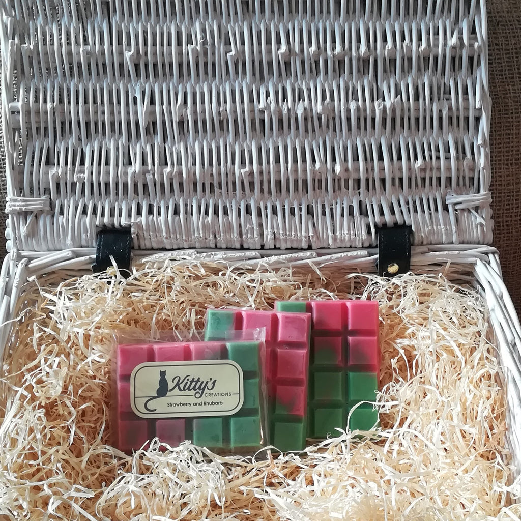 Three hand-made rectangular Wax Melts. Each is a coloured blend from green to pink mimicking how the balance of the fragrance is beautifully combined. Each melt is a nostalgic trip back to childhood fun, remember as you helped to harvest the strawberries and rhubarb in the summers that went on forever.