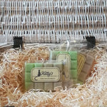 Three hand-made rectangular Wax Melts. Each is coloured a green like new fresh oak leaves blending to a light delicate brown, resting in a basket of straw. A rich sweet tobacco blended with spices and smoky oak woods, combine with incense and dark musk. This fragrance is comforting, and relaxing with a warmth of an evening well spent. Perfect for autumn as the nights draw in.
