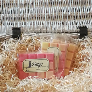 Three hand-made rectangular Wax Melts. Each is coloured flame pink, merging to a white-hot yellow, resting in a basket of straw. This fragrance transports you to your perfect fireside with bergamot, lemon, spices, red cedar, massoia wood and amber.