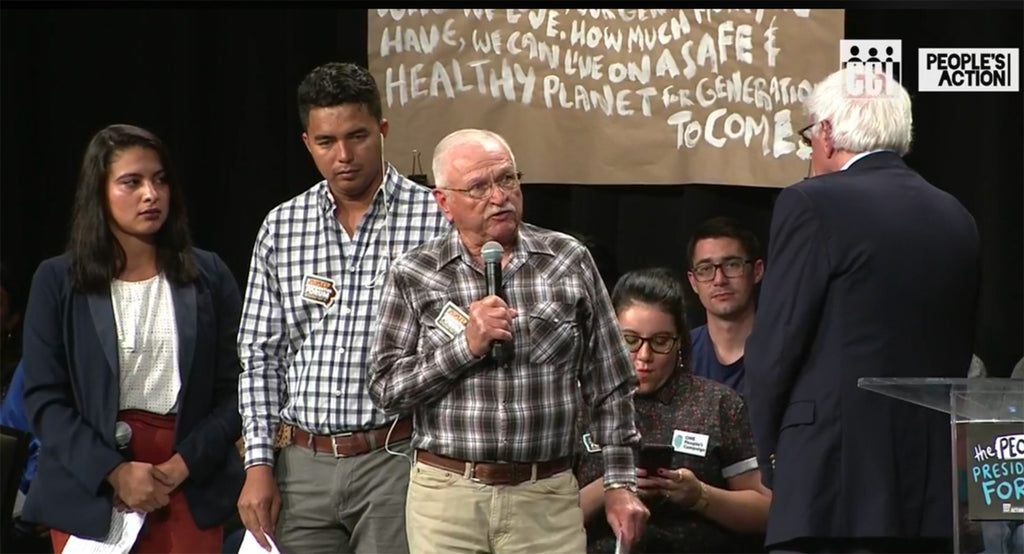 At last weekend's The People's Forum, Honduran farmworker and union organizer Ahrax Mayorga and Larry Ginter, a white, third-generation Iowa farmer, shared the stage, both dressed in plaid