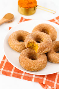 Fluffy baked pumpkin donuts, coated in cinnamon sugar