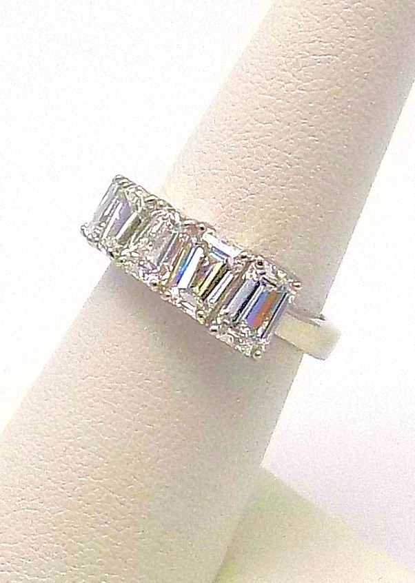 Platinum & Tapered and Graduated Emerald Cut Diamond Band
