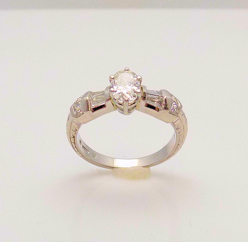 Platinum Engagement Ring with Oval Cut Diamond