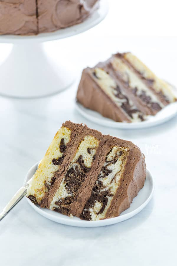 Try this easy homemade Gluten Free Marble Cake recipe – it's the perfect balance of chocolate and vanilla! This cake yields a tender crumb layered between creamy buttercream frosting – it's the birthday cake everyone's dreaming of!
