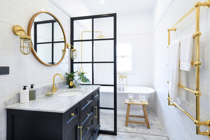 Gold accents have been gracing the most enviable bathrooms since, well, forever