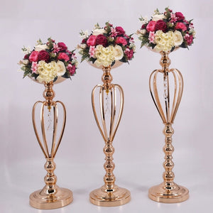 Elegant gold candle/flower holders