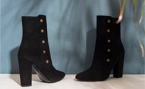 Image of black booties