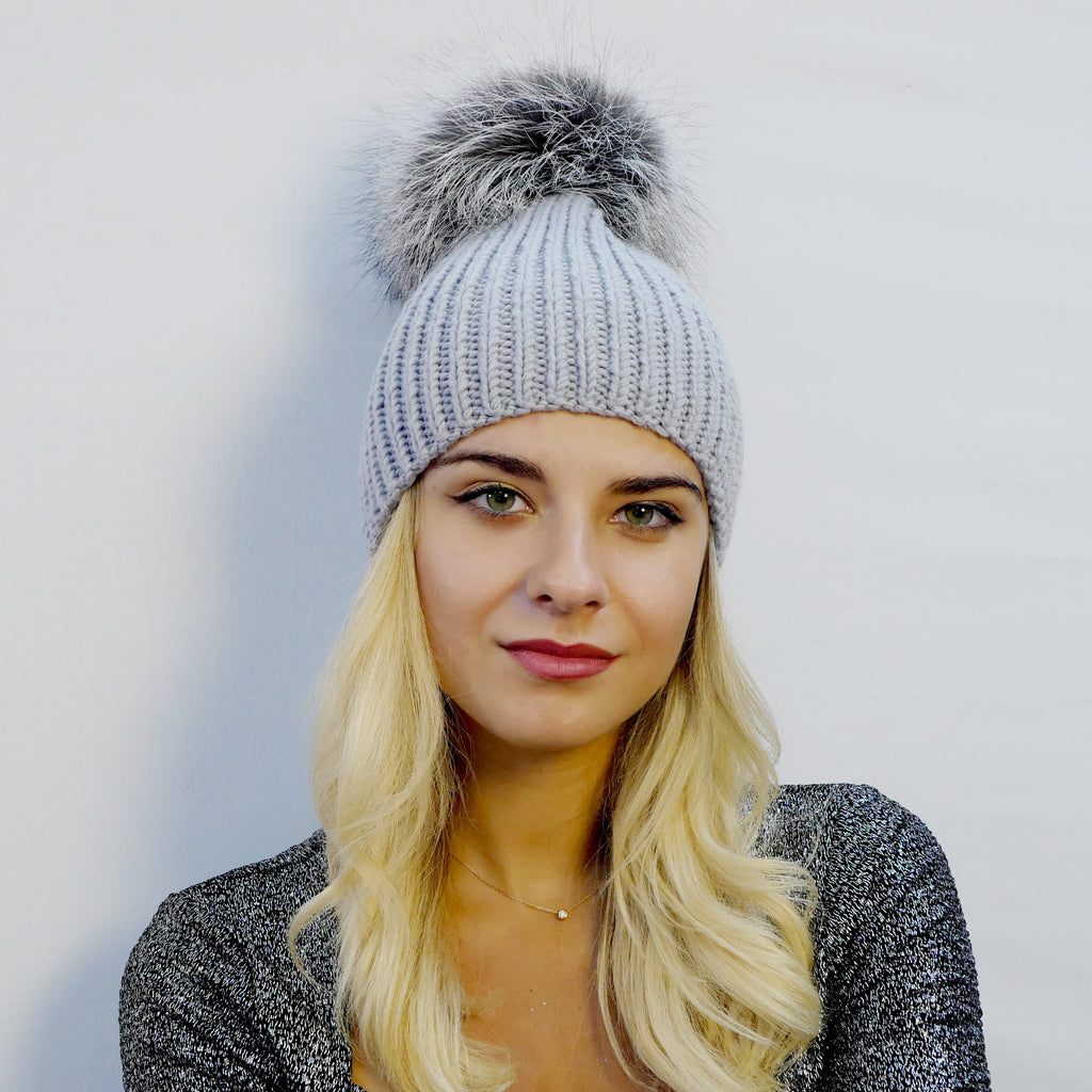 beanie hat ribbed handknitted in gray extra fine merino wool with an extra large silver fox fur pompom