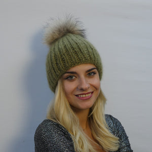 fur pom pom hat in moss green mohair with oversized fur pom pom