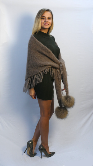 triangular scarf handknitted in beige soft mohair with finges and two finn raccoon fur pompom metching color