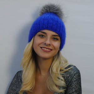 fur pom pom hat in royal blue mohair with large fur pom pom