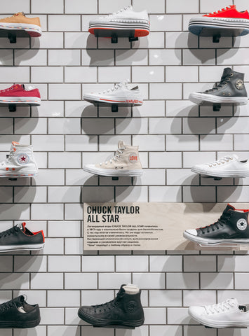 Wall of trainers in a shoe shop. Photo by La Miko from Pexels