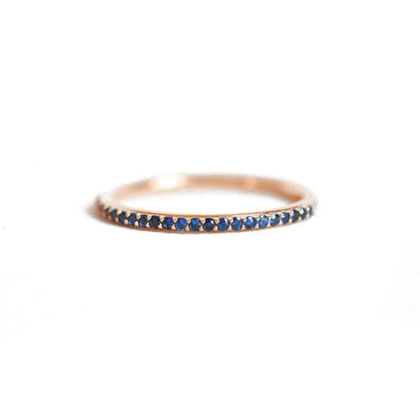 Delicate Shared Prong Sapphire Ring