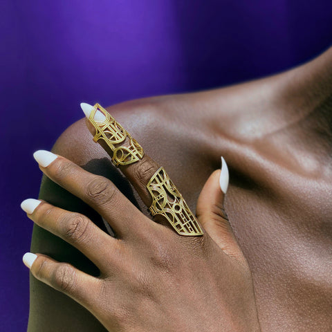 ROKUS articulated nail ring with a filigree design inspired by antique Akan gold sculptures.