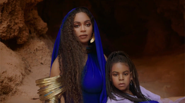 Beyonce wearing the ROKUS London Demi Fula gold hook earrings and seating with Blue Ivy in the Bigger video.