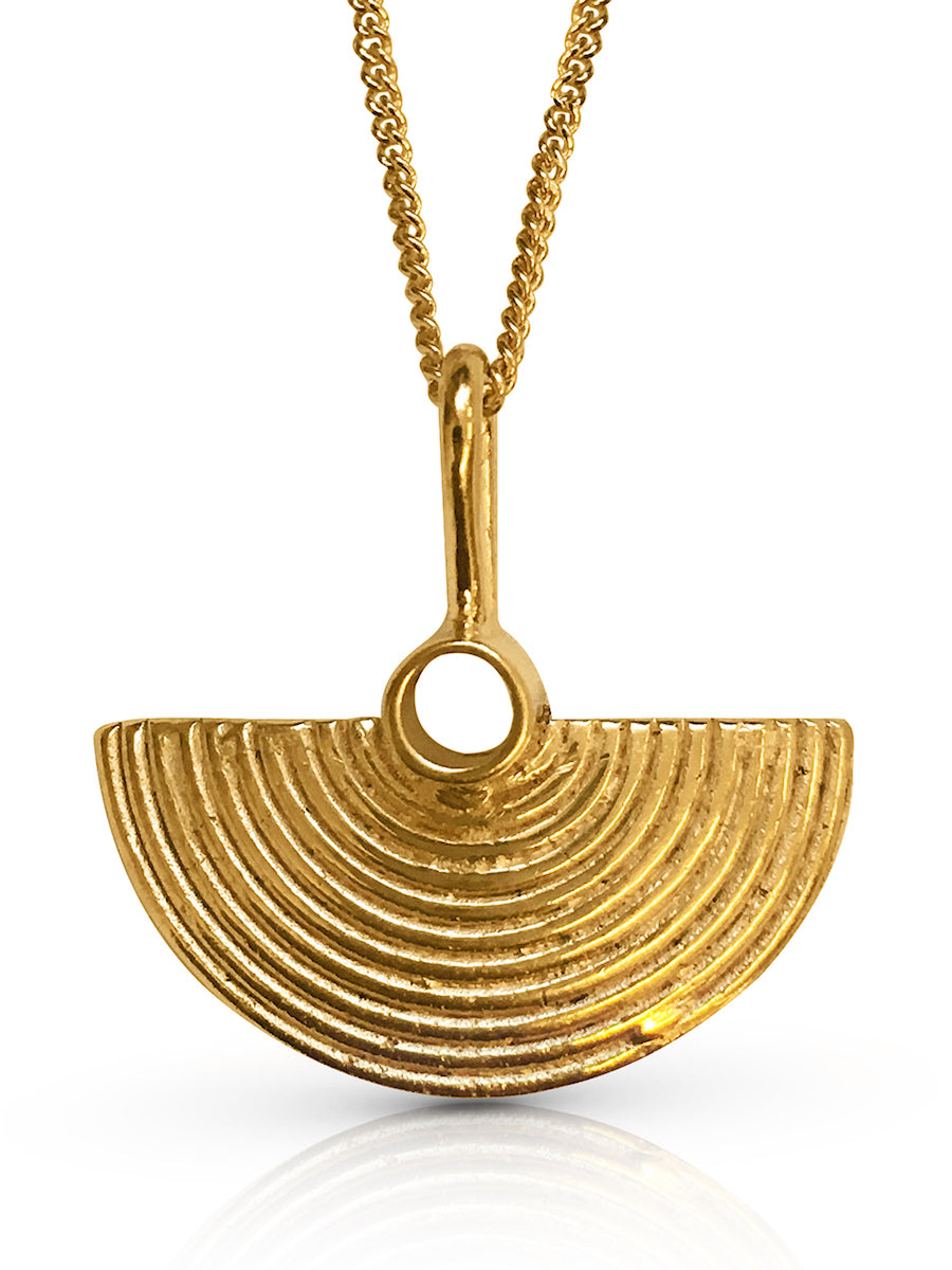 Gold finish half moon shaped pendant with fine lines texture on a fine curb chain made by ROKUS London.