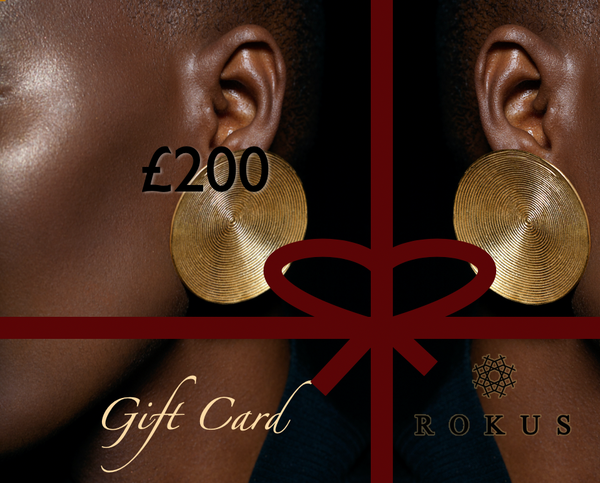£200 gift card to purchase ROKUS London jewellery. The picture includes gold Full Moon earrings by ROKUS.