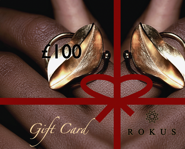 £100 gift card to purchase ROKUS London jewellery. The picture includes gold Fula Wrap Ring by ROKUS.