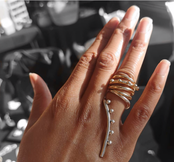 The long beaded ring and quad ring are like a little golden lasso that winds around the finger.