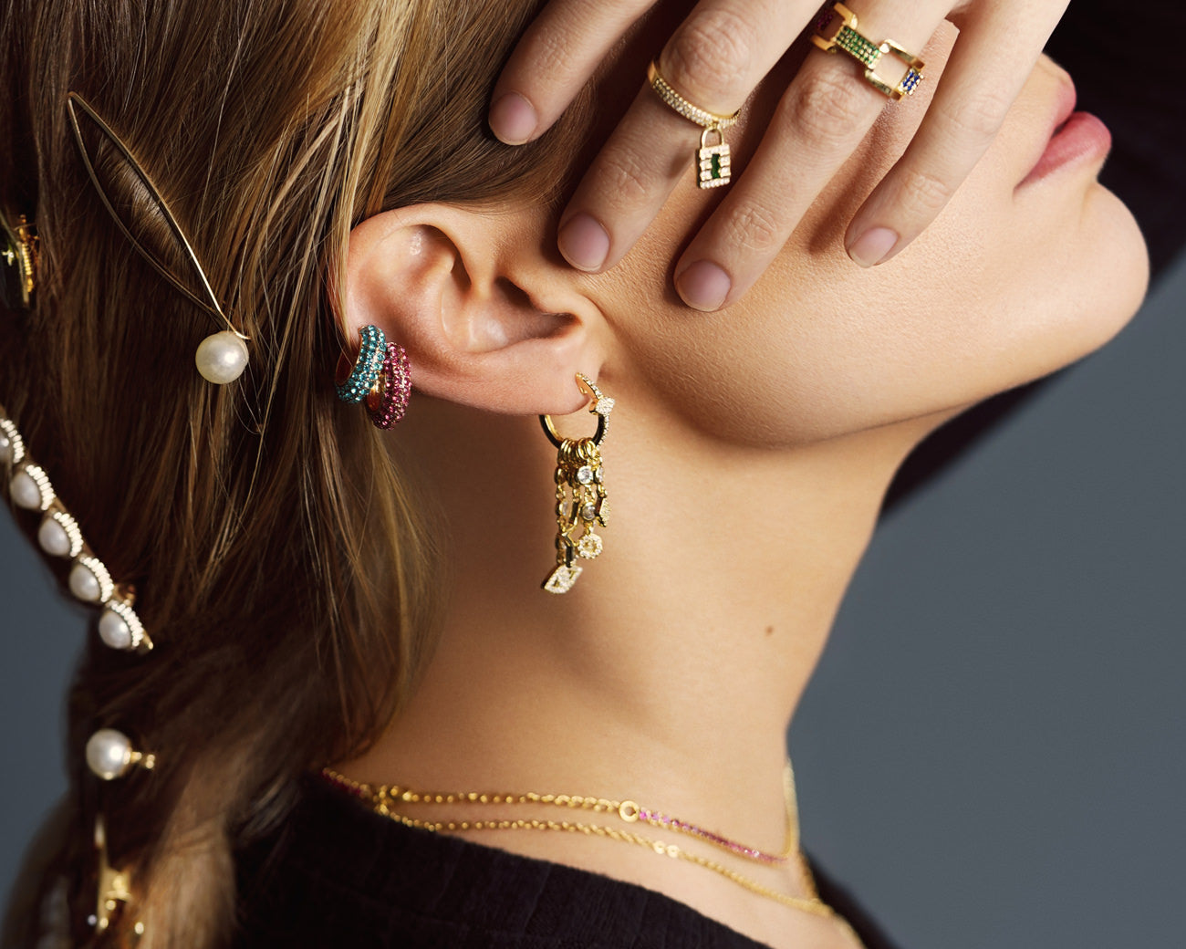 FAX Jewelry | 'Lucky Charms' Huggie Hoop Earrings in Gold | Model