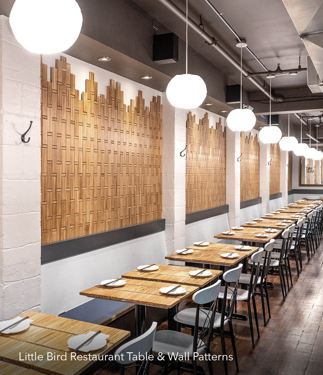 Custom eco-friendly wall paneling and tables for Little Bird restaurant