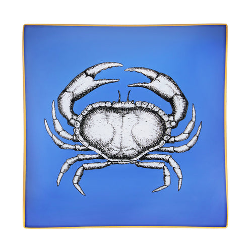 An artisanal, decorative glass valet tray with a crab illustration on a cornflower blue background finished with an 18kt gold leaf edging