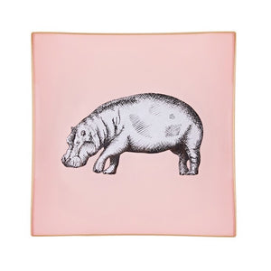 A decorative glass tray with a hippo illustration on a blush pink background finished with an 18kt gold leaf edging
