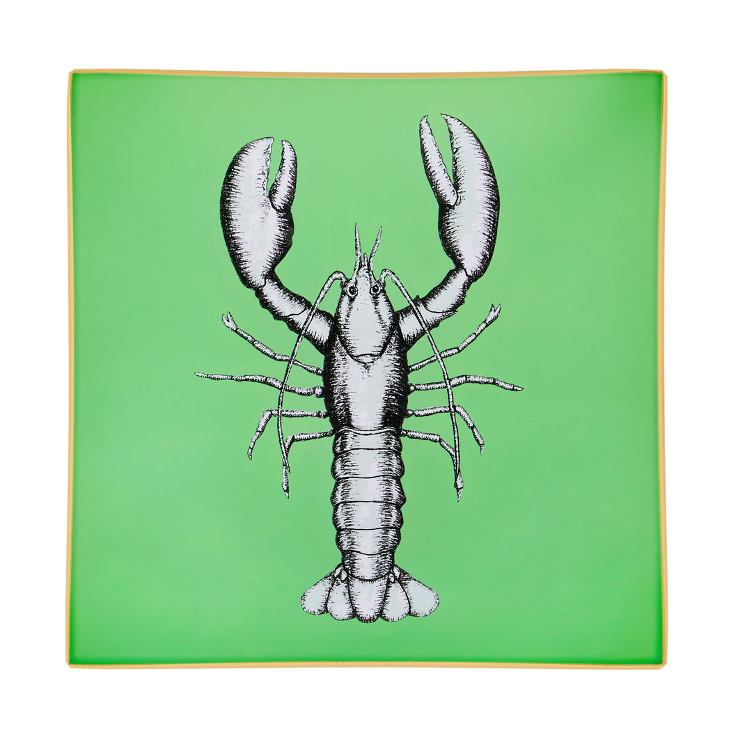 An artisanal, decorative glass valet tray with a lobster illustration on a mid green background finished with an 18kt gold leaf edging