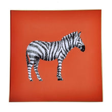 Load image into Gallery viewer, An artisanal, decorative glass valet tray with a zebra illustration on an orange background finished with an 18kt gold leaf edging
