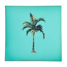 Load image into Gallery viewer, An artisanal, decorative glass valet tray with a palm tree illustration on a turquoise background finished with an 18kt gold leaf edging