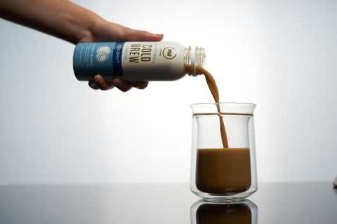 Coconut Cold Brew being poured into a cup