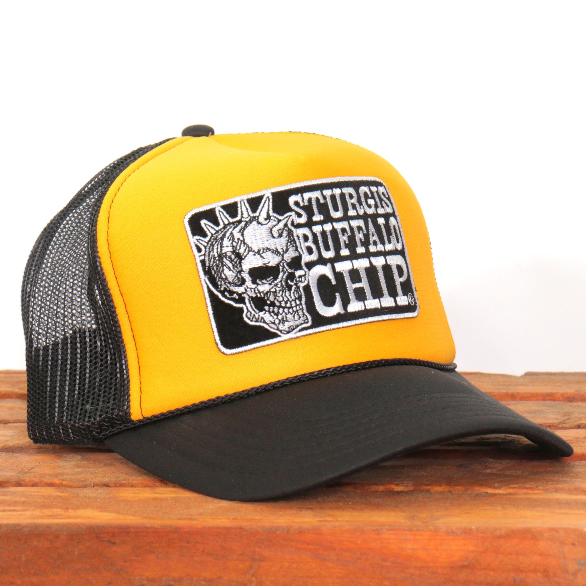 Official Sturgis Buffalo Chip Spiked Skull Trucker Hat (Yellow and Black)