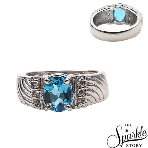 The Sparkle Story Blue Topaz Prong Setting Sterling Silver Ring for (DSS-12029)