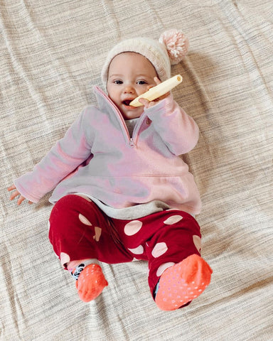 Baby Teething on a Baby Teether shaped as a Tube to promote chewing