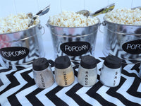 silver metal popcorn buckets with popcorn scoops
