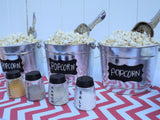 metal popcorn buckets with chalkboard labels