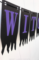spooky purple Halloween sign