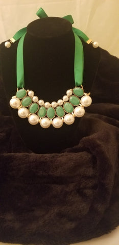 Green ribbon-tie and pearl necklace