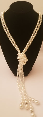 Double-knotted pearl necklace