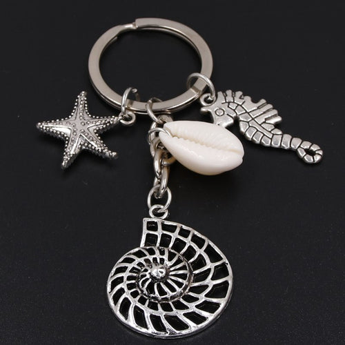 'Ladies' This One Is Absolutely For You! Silver Plate Key Ring With A Sea Horse A Starfish And A 'Really Cute' Conch Shell!